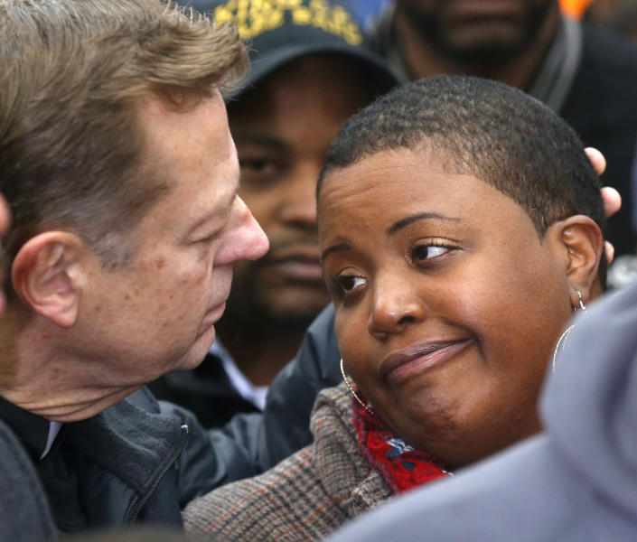 FILE-- In this Jan. 30, 2013 file photo, Rev. Michael Pfleger, left, consoles Cleopatra Pendleton during a news conference where Chicago Police Superintendent Garry McCarthy was seeking help from the public in solving the murder of Pendleton's daughter, Hadiya, in Chicago. As Illinois Gov. Pat Quinn mulls whether to sign off on eliminating the nation's last ban on public possession of guns, the question in Chicago is whether it will matter in the crime-weary city where a spiking murder rate drew national attention last year. (AP Photo/Charles Rex Arbogast, File)