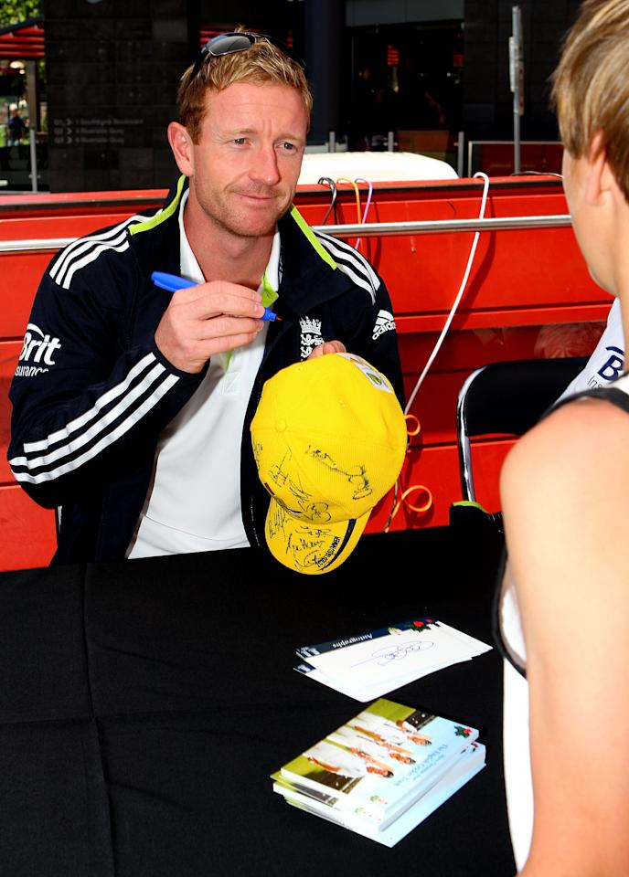 MELBOURNE, AUSTRALIA - DECEMBER 23:  Paul Collingwood of England signs his autograph for a fan during an Ashes fan day at Queensbridge Square on December 23, 2010 in Melbourne, Australia.  (Photo by Graham Denholm/Getty Images)