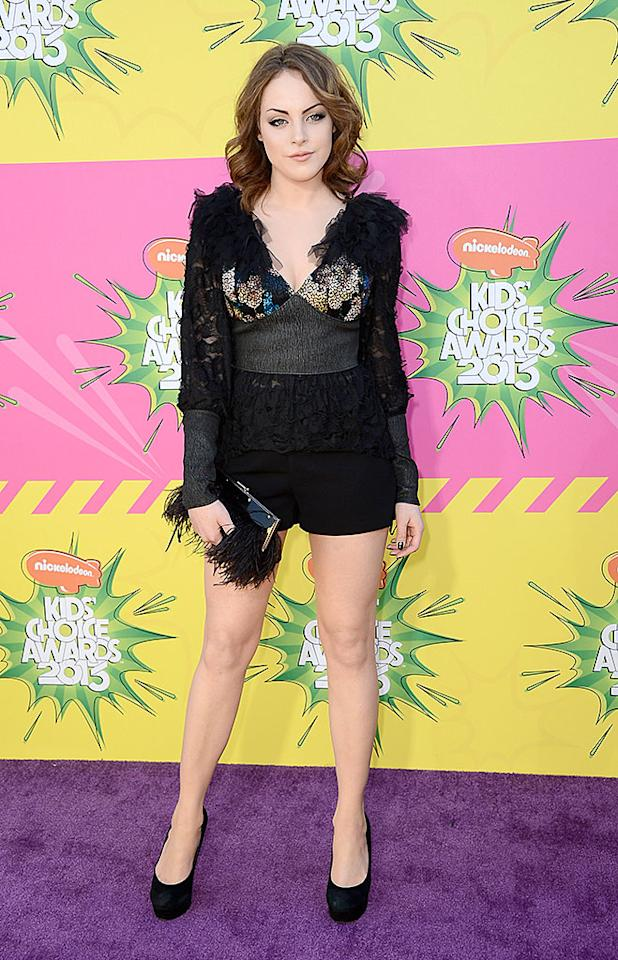 "Elizabeth Gillies (""Victorious"") showed off her gams in a pair of simple black short shorts and a rather busy top. Are you a fan of the look?"