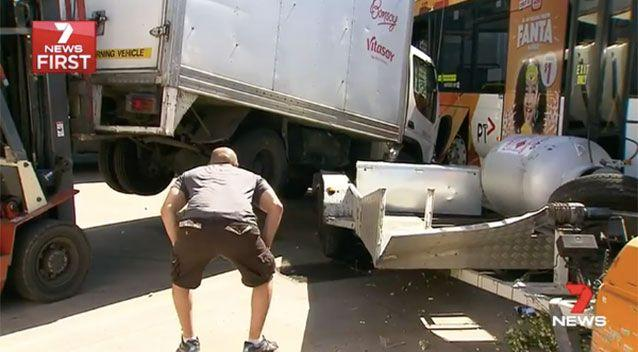 A truck was wedged into the side of the bus. Source: 7 News