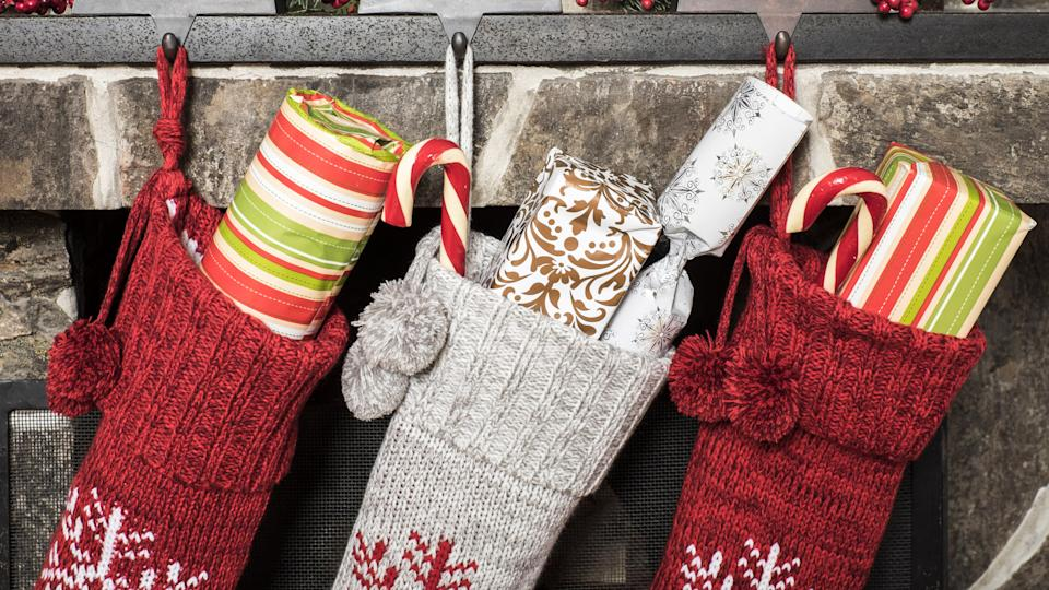 Stuffed stockings hanging on a fireplace on christmas morning.