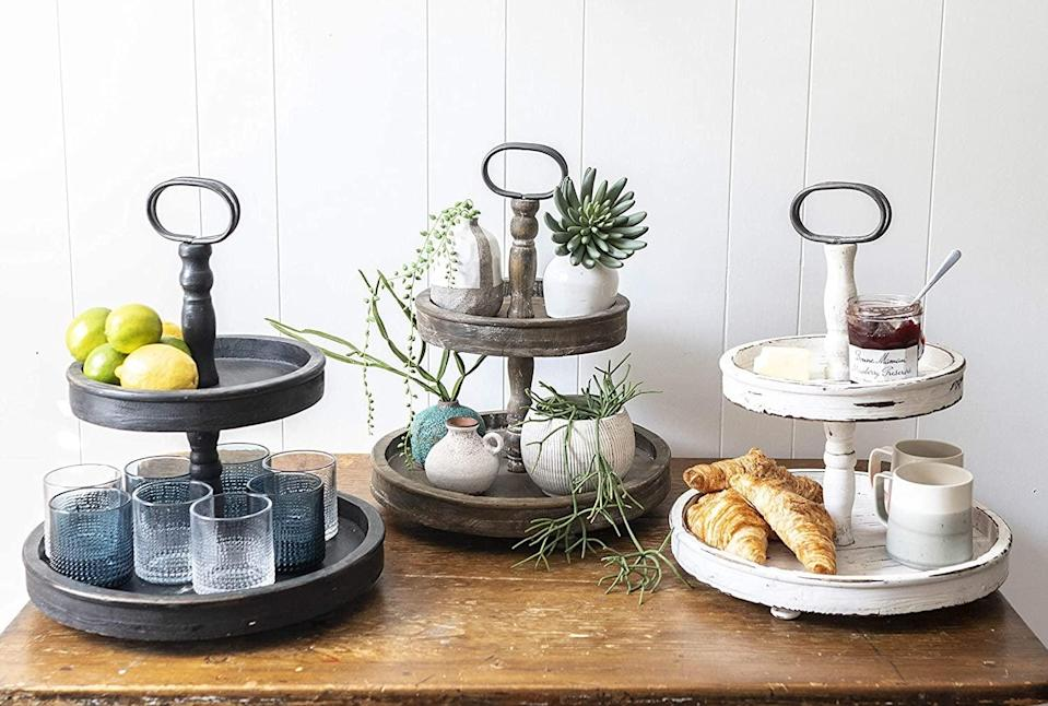 <p>The <span>Creative Co-Op EC0112 Distressed Wood 2-Tier Tray With Metal Handle</span> ($58) is a cute and functional way to display your plants and trinkets, store makeup or jewelry, or even use as a serving platter.</p>