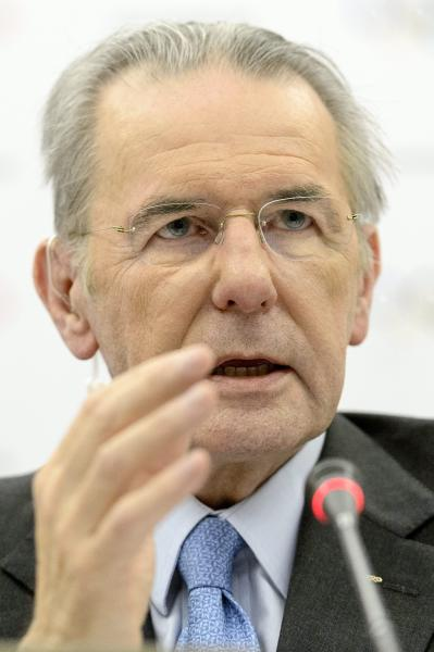International Olympic Committee, IOC, President Jacques Rogge attends a press conference after the last day of the executive board's meeting, in Lausanne, Switzerland, Wednesday, Feb. 13, 2013. IOC President Jacques Rogge says he will meet with the head of wrestling's governing body to discuss ways the sport can fight to save its place in the 2020 Olympics. The IOC executive board dropped wrestling from the program of the 2020 Games on Tuesday, removing it from the list of 26 sports contested at last year's London Olympics. The decision, which still must be ratified by the full IOC in September, has been widely criticized by wrestling organizations around the world. (AP Photo/Keystone,/Laurent Gillieron)