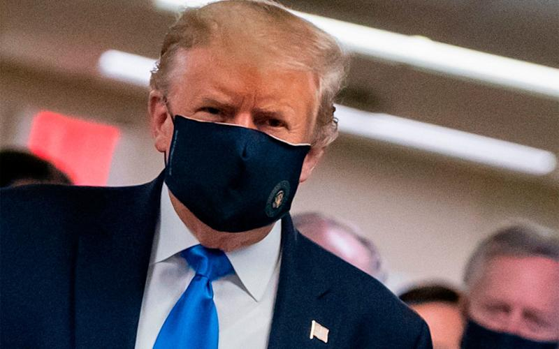 US President Donald Trump wears a mask as he visits Walter Reed National Military Medical Centre in Bethesda, Maryland - ALEX EDELMAN/AFP