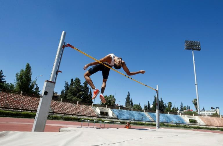Syrian high jumper Majd Eddin Ghazal, pictured training in Damasus, will compete in his fourth Olympics in Tokyo