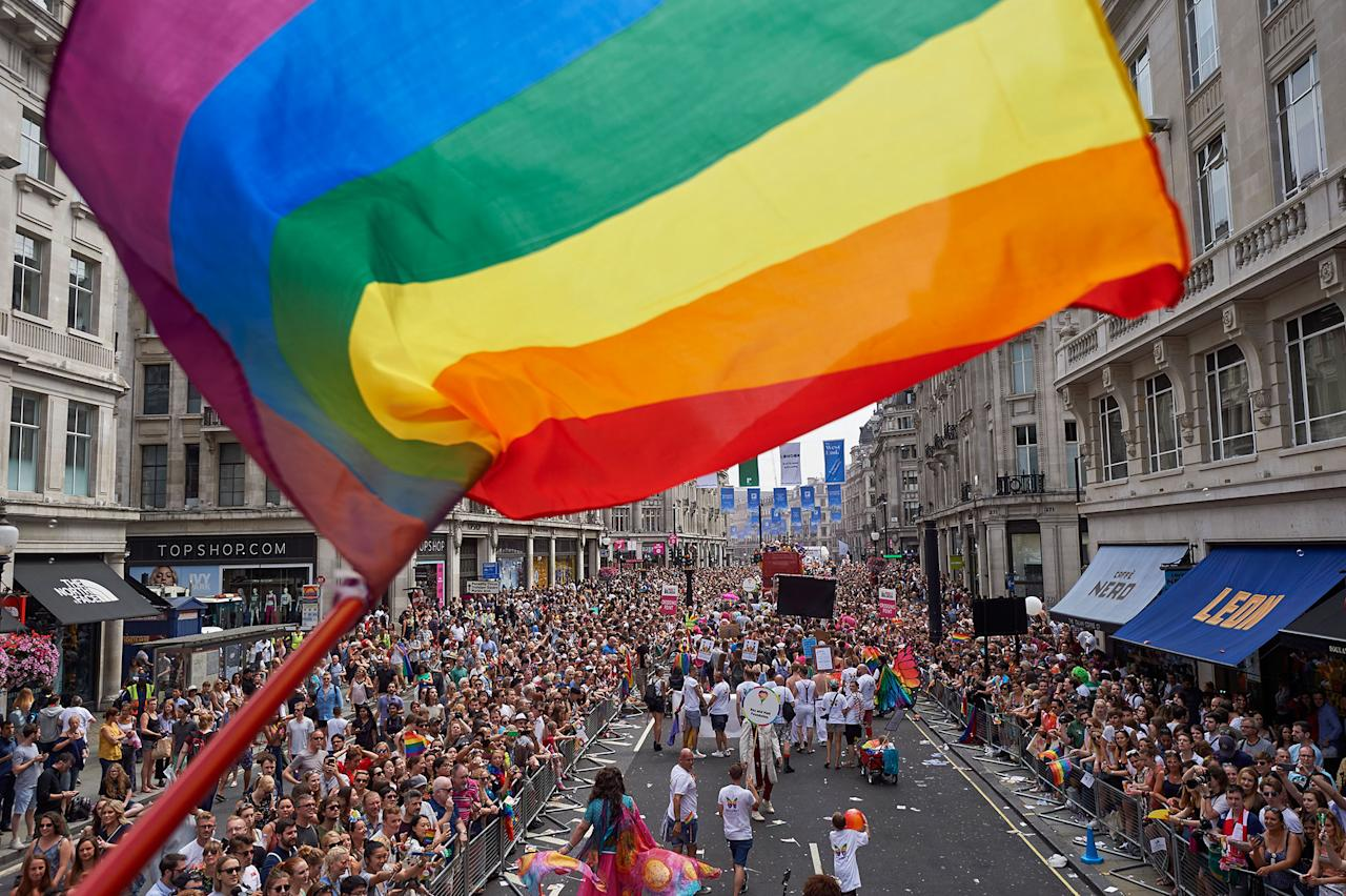 <p>Members of the Lesbian, Gay, Bisexual and Transgender (LGBT) community take part in the annual Pride Parade in London on July 8, 2017. (Photo: Niklas Halle'n/AFP/Getty Images) </p>