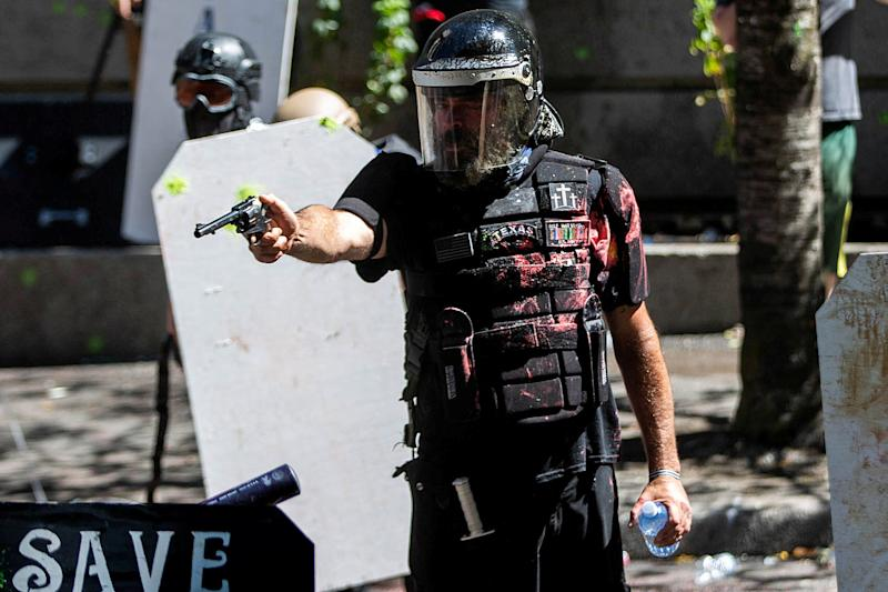 Alan Swinney points a gun during clashes between far-right groups and anti-fascist protesters in Portland, Oregon, on Aug. 22, 2020. (Photo: Maranie Staab / Reuters)
