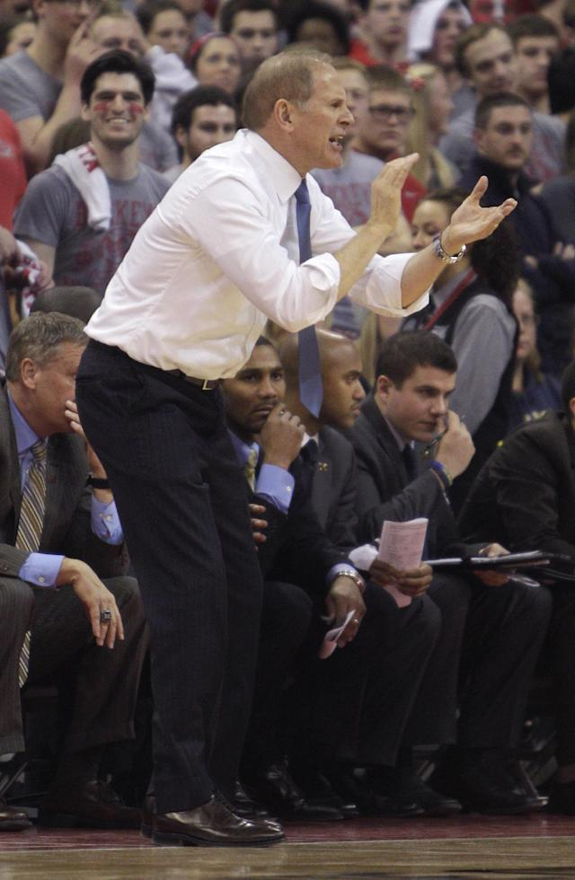 Michigan coach John Beilein cheers for his team during the first half of an NCAA college basketball game against Ohio State, Tuesday, Feb. 11, 2014, in Columbus, Ohio. (AP Photo/Jay LaPrete)