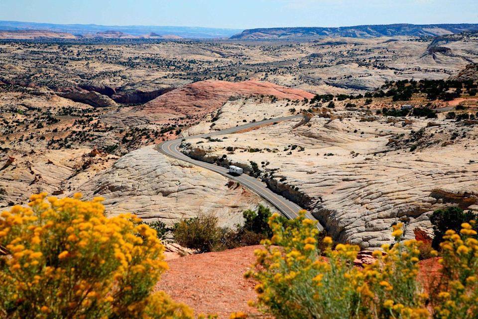 """<p><strong>The Drive: </strong><a href=""""https://www.tripadvisor.com/ShowUserReviews-g60758-d145843-r489416036-Highway_12_Scenic_Byway-Torrey_Utah.html"""" rel=""""nofollow noopener"""" target=""""_blank"""" data-ylk=""""slk:All-American Road"""" class=""""link rapid-noclick-resp"""">All-American Road</a></p><p><strong>The Scene:</strong> Scenic Byway 12 starts in Panguitch and travels east through various national parks, forests, and other nature sightings. It takes about three hours to complete, but you'll want to spend the day making stops throughout the roughly 123-mile route for an exciting day trip. </p><p><strong>The Pit-Stop:</strong> When standing at <a href=""""https://www.tripadvisor.com/LocationPhotoDirectLink-g28965-d146426-i221376673-Grand_Staircase_Escalante_National_Monument-Utah.html"""" rel=""""nofollow noopener"""" target=""""_blank"""" data-ylk=""""slk:Head of the Rocks Overlook"""" class=""""link rapid-noclick-resp"""">Head of the Rocks Overlook</a>, you'll get endless views of the <a href=""""https://www.tripadvisor.com/Tourism-g56980-Escalante_Utah-Vacations.html"""" rel=""""nofollow noopener"""" target=""""_blank"""" data-ylk=""""slk:Escalante Canyons"""" class=""""link rapid-noclick-resp"""">Escalante Canyons</a>. </p>"""