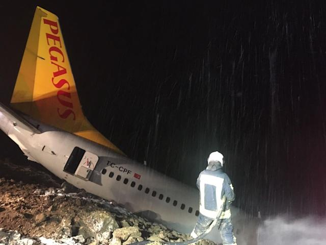<p>A Pegasus airplane carrying 162 passengers is seen stuck in mud as it skidded off the runway after landing in Trabzon Airport, Turkey early Sunday on Jan. 14, 2018. (Photo: Tugba Yardimci/Anadolu Agency/Getty Images) </p>