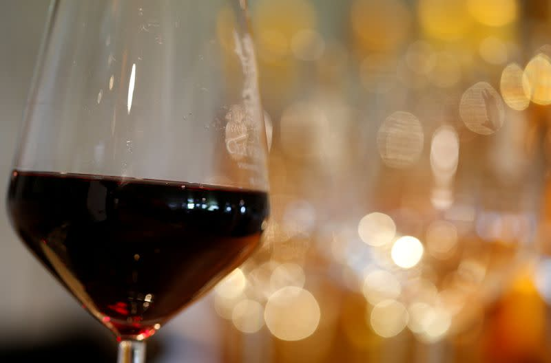 FILE PHOTO: A glass of French red wine is displayed at the Chateau du Pavillon in Sainte-Croix-Du-Mont,