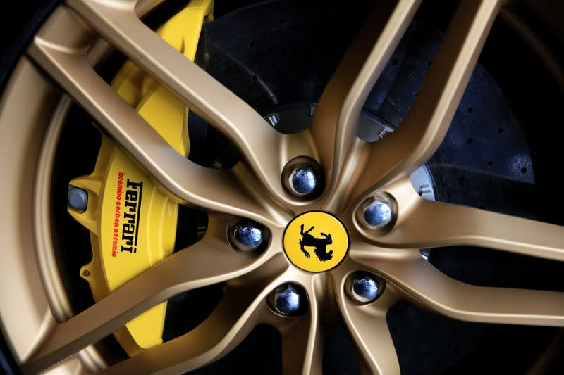 The Ferrari logo on the wheel of a car at a dealership in Singapore