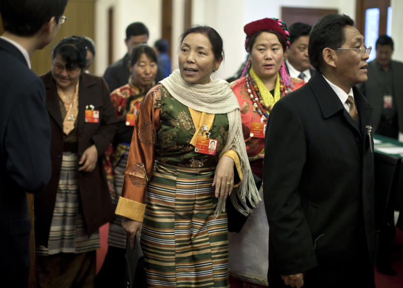 Tibetan delegates arrive to the Tibet room inside the Great Hall of the People to attend the Tibetan province delegation meeting held as part of the National People's Congress in Beijing, China, Wednesday, March 7, 2012. Chinese officials sought Wednesday to discredit Tibetans who have set themselves on fire to protest China's rule over their region, calling them outcasts, criminals and mentally ill people manipulated by the exiled Dalai Lama. (AP Photo/Andy Wong)