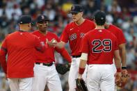 Boston Red Sox manager Alex Cora, left, relieves Nick Pivetta, center, during the sixth inning of a baseball game against the New York Yankees, Saturday, Sept. 25, 2021, in Boston. (AP Photo/Michael Dwyer)