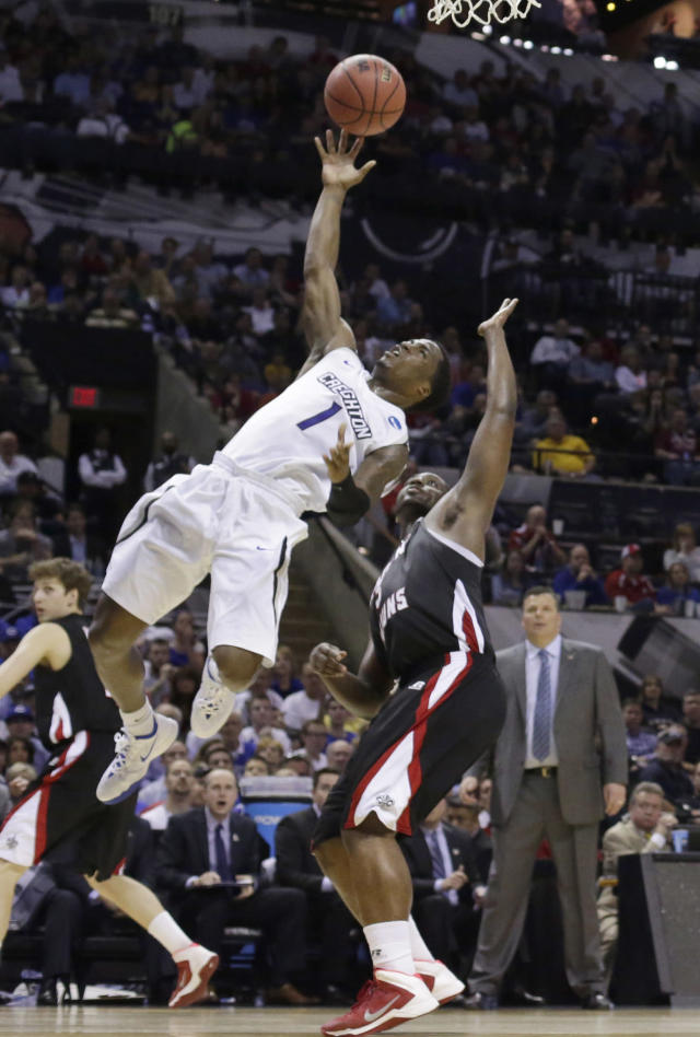 Creighton's Austin Chatman (1) scores over Louisiana-Lafayette's Xavian Rimmer (3) during the second half of a second-round game in the NCAA college basketball tournament Friday, March 21, 2014, in San Antonio. Creighton won 76-66. (AP Photo/Eric Gay)