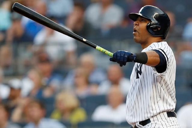New York Yankees designated hitter Edwin Encarnacion watches his solo home run during the second inning of the team's baseball game against the Tampa Bay Rays, Tuesday, July 16, 2019, in New York. (AP Photo/Kathy Willens)