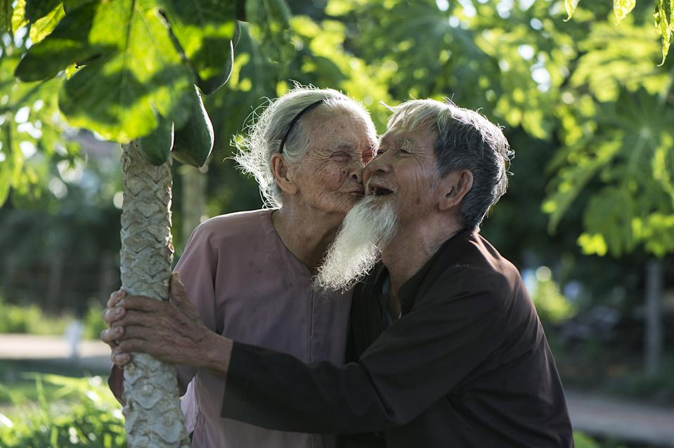"""This couple living in Hoi An, central Vietnam, was known as the happiest couple in the village: """"They are the happy people I have seen, they are 95 years old and they love each other very much. They always smile, maybe the smile helps them always be together and happy. Many photographers take photos of them, but sadly the old woman passed away a year ago. Since then, no one has come to take photos of him anymore - he is very sad, but I still visit him often and take photos of the moments he remembers her. If I win, I will use money to buy medicine to help him treat and improve his health, wishing for him to live to 100 years old."""". [Photo: SWNS]"""