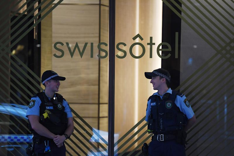"NSW Police stand guard outside the Swissotel Hotel in Market Street, Sydney, Thursday, March 26, 2020. The hotel has been declared a ""human health response zone"", believed to be holding Australian passengers from the Norwegian Jewel cruiseliner. Source: AAP"
