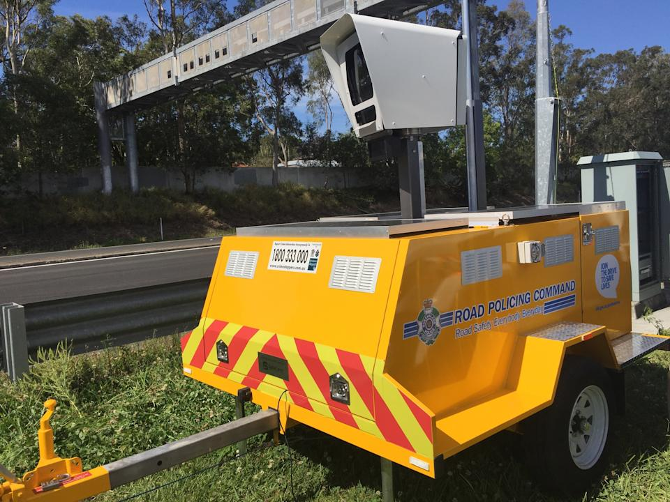 Picture of a mobile speed camera being used on the road in Queensland.