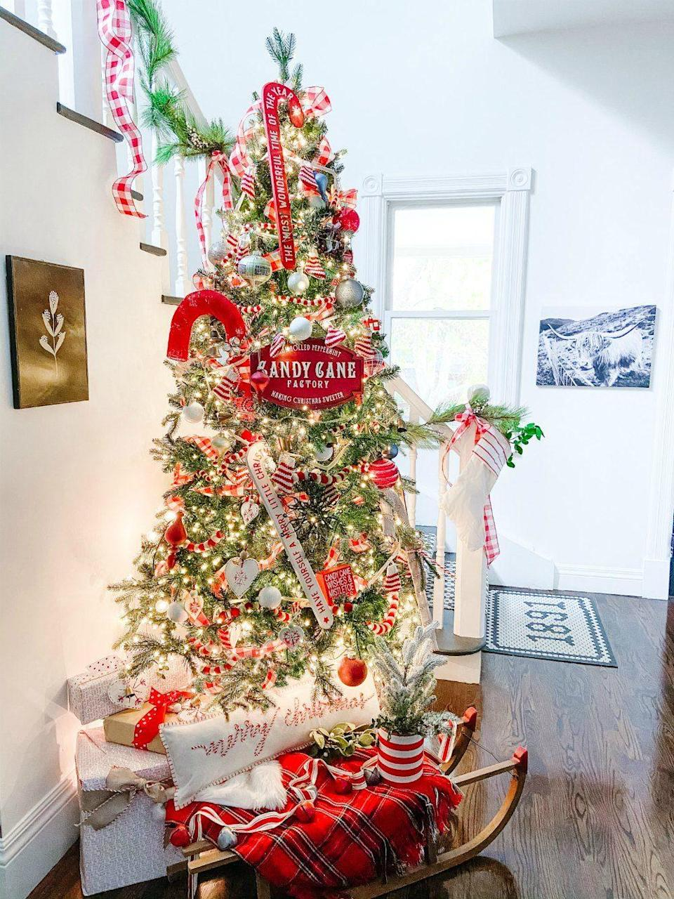 """<p>For another classic Christmas look with a nontraditional twist, switch out your regular red and white tree decorations for these candy cane-themed ones. </p><p><strong><em>Get the tutorial at <a href=""""https://tatertotsandjello.com/candy-cane-themed-christmas-tree/"""" rel=""""nofollow noopener"""" target=""""_blank"""" data-ylk=""""slk:Tatertots & Jello"""" class=""""link rapid-noclick-resp"""">Tatertots & Jello</a>.</em></strong></p><p><a class=""""link rapid-noclick-resp"""" href=""""https://www.amazon.com/Kurt-Adler-Candy-Ornament-Piece/dp/B002TH3IHY?tag=syn-yahoo-20&ascsubtag=%5Bartid%7C10070.g.2025%5Bsrc%7Cyahoo-us"""" rel=""""nofollow noopener"""" target=""""_blank"""" data-ylk=""""slk:BUY CANDY CANE DECORATIONS"""">BUY CANDY CANE DECORATIONS</a><br></p>"""