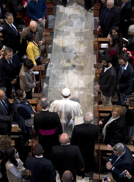 Pope Francis arrives to the Basilica of St. Bartholomew in Rome, Saturday, April 22, 2017, to celebrate a Liturgy of the Word in memory of the martyrs of the 20th and 21st centuries. (Maurizio Brambatti/Pool photo via AP)