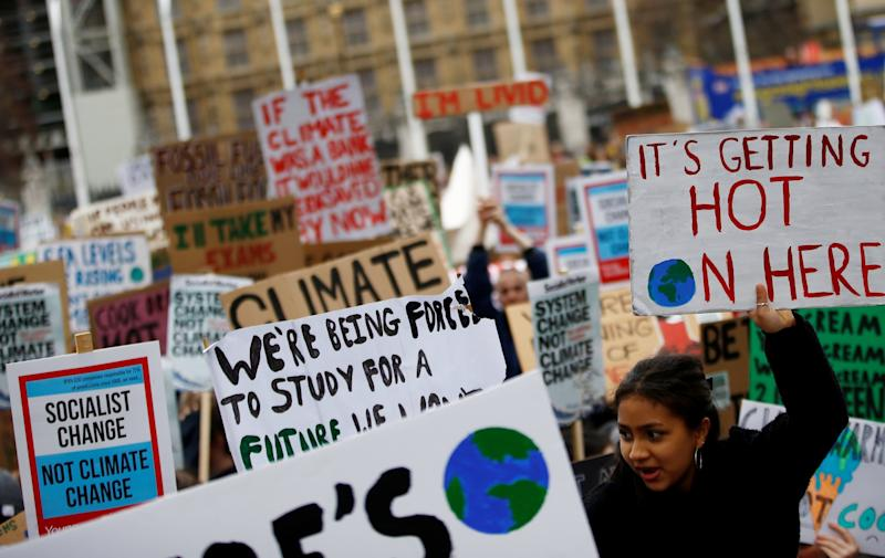 Young climate change protesters in London (Reuters)