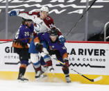 Colorado Avalanche's Nathan MacKinnon gets sandwiched between Arizona Coyotes' Dryden Hunt, right, and Niklas Hjalmarsson during the first period of an NHL hockey game Saturday, Feb. 27, 2021, in Glendale, Ariz. (AP Photo/Darryl Webb)