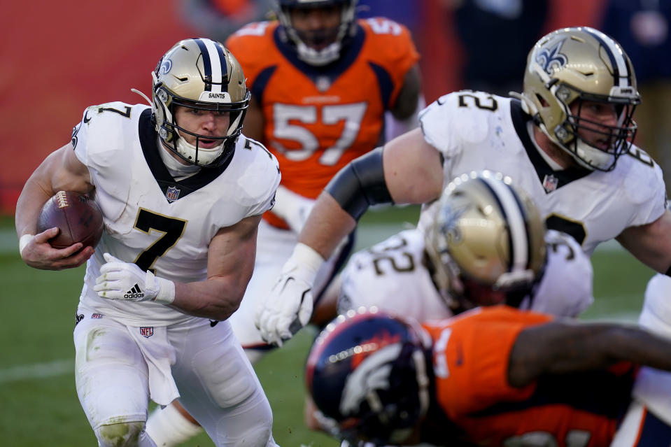 New Orleans Saints quarterback Taysom Hill (7) runs in for a touchdown during the first half of an NFL football game against the Denver Broncos, Sunday, Nov. 29, 2020, in Denver. (AP Photo/David Zalubowski)