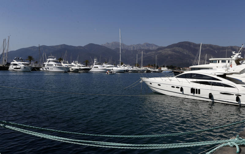 In this photo taken Wednesday, March 15, 2017, is a view to Porto Montenegro, one of the biggest and most luxurious of all the yachting marinas on the Adriatic, in Tivat, Montenegro. Russian tourists are flocking to Montenegro despite warnings from Moscow against their visits to the latest NATO-member country. (AP Photo/Darko Vojinovic)