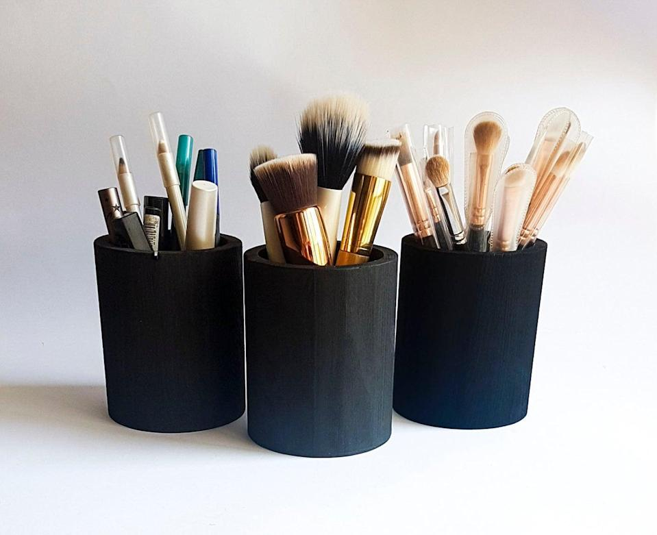 "<p>If you like to keep things simple or have an ""all black everything"" aesthetic, these <span>Black Wooden Makeup Brush Holders</span> ($18) are a must-have.</p>"