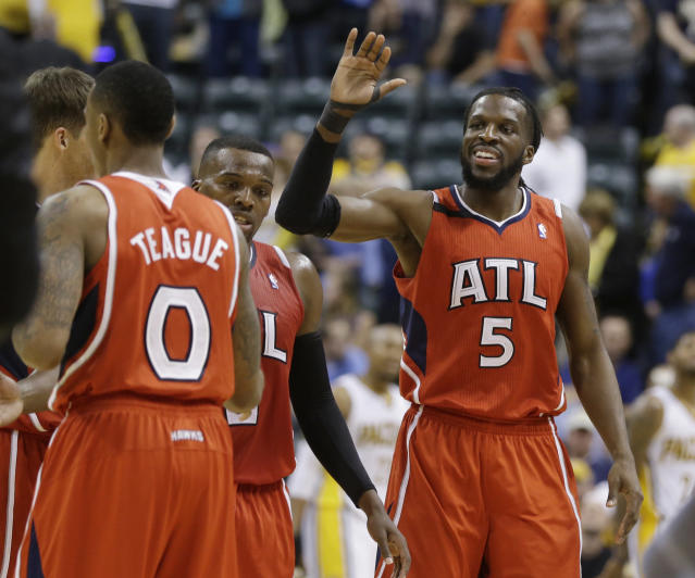 Atlanta Hawks' DeMarre Carroll (5) celebrates with his teammates late in the second half in Game 5 of an opening-round NBA basketball playoff series against the Indiana Pacers Monday, April 28, 2014, in Indianapolis. Atlanta defeated Indiana 107-97. (AP Photo/Darron Cummings)