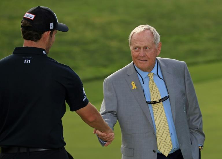 Golf legend Jack Nicklaus, at right shaking hands with 2019 Memorial tournament winner Patrick Cantlay, will not be welcoming spectators to his PGA event next week at Muirfield Village after a spike in COVID-19 cases across Ohio