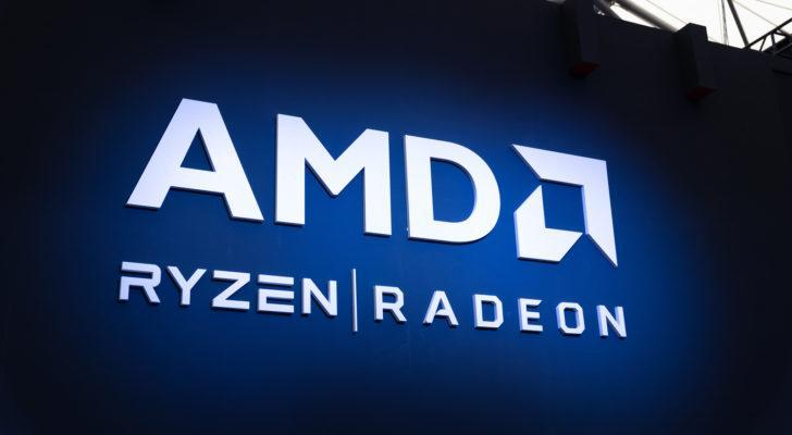 Advanced Micro Devices (AMD) logo on blue background with Ryzen and Radeon brands