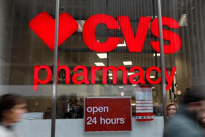 """FILE - In this Oct. 21, 2016 file photo, a CVS drugstore and pharmacy in Philadelphia. Three years after a wait-time scandal, the Veterans Affairs Department is hoping a private-sector partnership with the CVS Pharmacy chain will reduce some of its strain in providing timely urgent care. The new initiative announced Tuesday, April 18, 2017, is a pilot program that allows ailing veterans who receive treatment at the Phoenix VA medical center to access one of 24 """"MinuteClinics"""" operated by CVS for treatment of minor illnesses and injuries, such as respiratory infections or to order lab tests. (AP Photo/Matt Rourke, File)"""