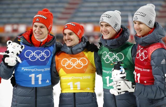 Ski Jumping - Pyeongchang 2018 Winter Olympics - Men's Team Final - Alpensia Ski Jumping Centre - Pyeongchang, South Korea - February 19, 2018 - Silver medalists Karl Geiger, Stephan Leyhe, Richard Freitag and Andreas Wellinger of Germany celebrate during the victory ceremony. REUTERS/Dominic Ebenbichler
