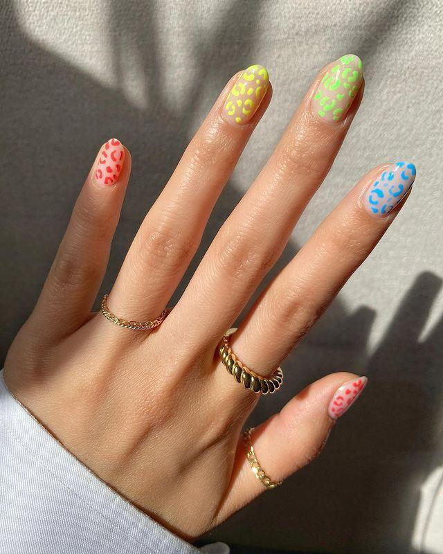 "<p>It's hard not to be obsessed with this neon leopard <a href=""https://www.cosmopolitan.com/style-beauty/beauty/g34696587/aquarius-nail-art-ideas/"" rel=""nofollow noopener"" target=""_blank"" data-ylk=""slk:nail trend"" class=""link rapid-noclick-resp"">nail trend</a>. You'll need a <a href=""https://www.amazon.com/Galleria-Striping-Detailing-One-Stroke-Painting/dp/B07JW88XCX/ref=asc_df_B07JW88XCX/?tag=syn-yahoo-20&ascsubtag=%5Bartid%7C10049.g.34702993%5Bsrc%7Cyahoo-us"" rel=""nofollow noopener"" target=""_blank"" data-ylk=""slk:nail art brush set"" class=""link rapid-noclick-resp"">nail art brush set</a> and a few different <a href=""https://www.amazon.com/Kleancolor-Neon-Nail-Lacquer-Colors/dp/B003G0S7S8?tag=syn-yahoo-20&ascsubtag=%5Bartid%7C10049.g.34702993%5Bsrc%7Cyahoo-us"" rel=""nofollow noopener"" target=""_blank"" data-ylk=""slk:neon polish"" class=""link rapid-noclick-resp"">neon polish</a> shades to create these colorful spots. Seal it all in with a glossy <a href=""https://go.redirectingat.com?id=74968X1596630&url=https%3A%2F%2Fwww.ulta.com%2Fdry-fast-top-coat%3FproductId%3Dprod6051231&sref=https%3A%2F%2Fwww.cosmopolitan.com%2Fstyle-beauty%2Fbeauty%2Fg34702993%2F2021-nail-trends%2F"" rel=""nofollow noopener"" target=""_blank"" data-ylk=""slk:top coat"" class=""link rapid-noclick-resp"">top coat</a> and you're good to go. </p><p><a href=""https://www.instagram.com/p/CB56QWUnOAT/?utm_source=ig_embed&utm_campaign=loading"" rel=""nofollow noopener"" target=""_blank"" data-ylk=""slk:See the original post on Instagram"" class=""link rapid-noclick-resp"">See the original post on Instagram</a></p>"