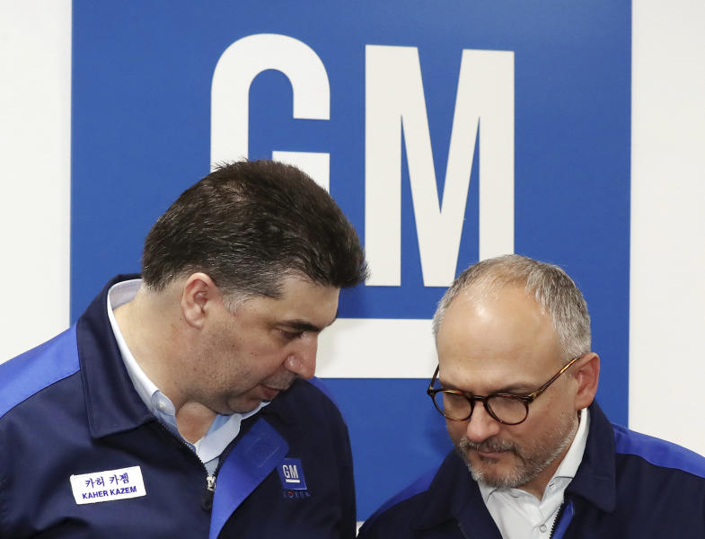GM Korea CEO Kaher Kazem, left, talks with GM Executive Vice President Barry Engle after a tentative agreement reached between the GM Korea's management and labor union at GM Korea's factory in Bupyeong, South Korea, Monday, April 23, 2018. General Motors says it has reached a tentative agreement with its South Korean labor union to a set of measures to cut costs and allocate new car models to existing GM Korea factories. (Yun Tae-hyung/Yonhap via AP)