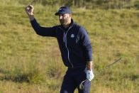 Team USA's Dustin Johnson reacts on the third hople during a foursomes match the Ryder Cup at the Whistling Straits Golf Course Saturday, Sept. 25, 2021, in Sheboygan, Wis. (AP Photo/Charlie Neibergall)