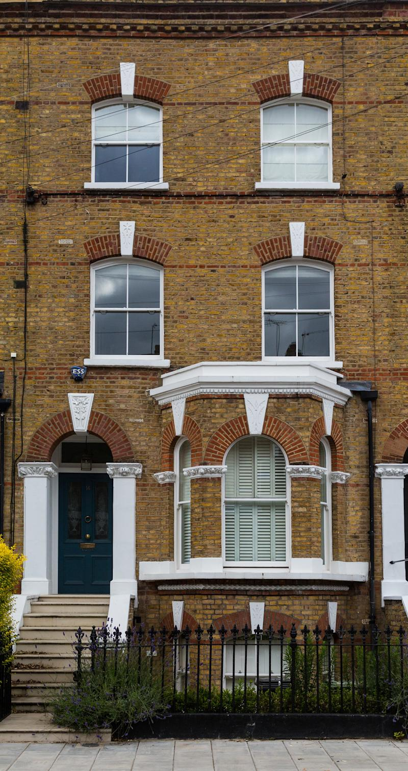 The house in Clapham, London, where a suspected stowaway fell from the aircraft's undercarriage bay, landing in the garden (Picture: SWNS)