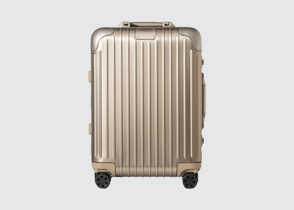 "<p>""I often have to cart my suitcase around to meetings; my Rimowa is sleek enough to sit in boardrooms, durable enough to get banged around, and lightweight so that lugging it isn't a chore."" <em>—Tom Marchant, owner and co-founder,</em> <a href=""https://www.blacktomato.com/us/"" rel=""nofollow noopener"" target=""_blank"" data-ylk=""slk:Black Tomato"" class=""link rapid-noclick-resp""><em>Black Tomato</em></a></p> <p><strong>Shop now:</strong> <a href=""https://fave.co/2TLy4T6"" rel=""nofollow noopener"" target=""_blank"" data-ylk=""slk:rimowa.com"" class=""link rapid-noclick-resp"">rimowa.com</a></p>"