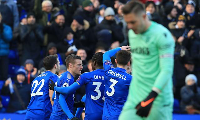 Leicester players celebrate as a dejected Jack Butland reflects on his own goal.