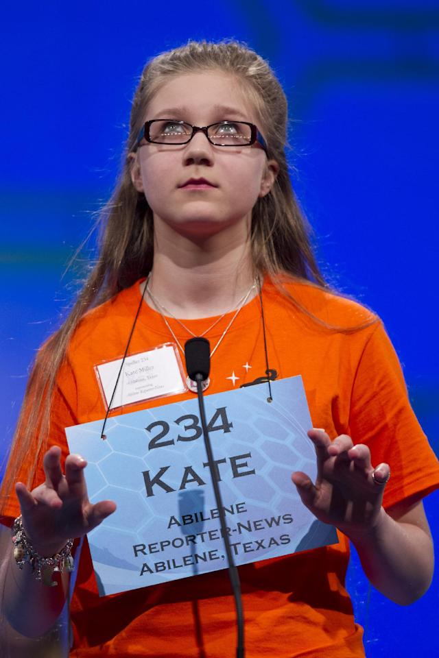 "Kate Miller, of Abilene, Texas, spells ""fougade"" during the second round of the National Spelling Bee, Wednesday, May 30, 2012, in Oxon Hill, Md. (AP Photo/Evan Vucci)"