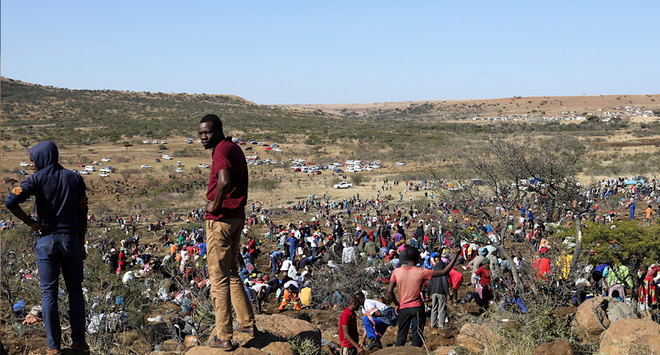 A crowd of people in the desert in South Africa. Source: Reuters
