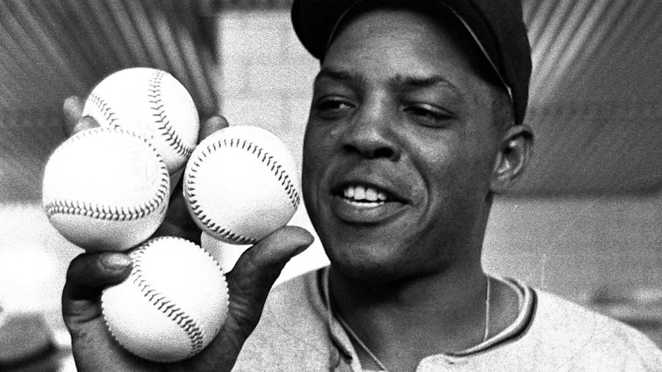 Mandatory Credit: Photo by Dvn/AP/Shutterstock (6620428a)San Francisco Giants star outfielder, Willie Mays, proudly displays the four baseballs in the clubhouse representing the four homers which he hit against the Milwaukee Braves in Milwaukee.