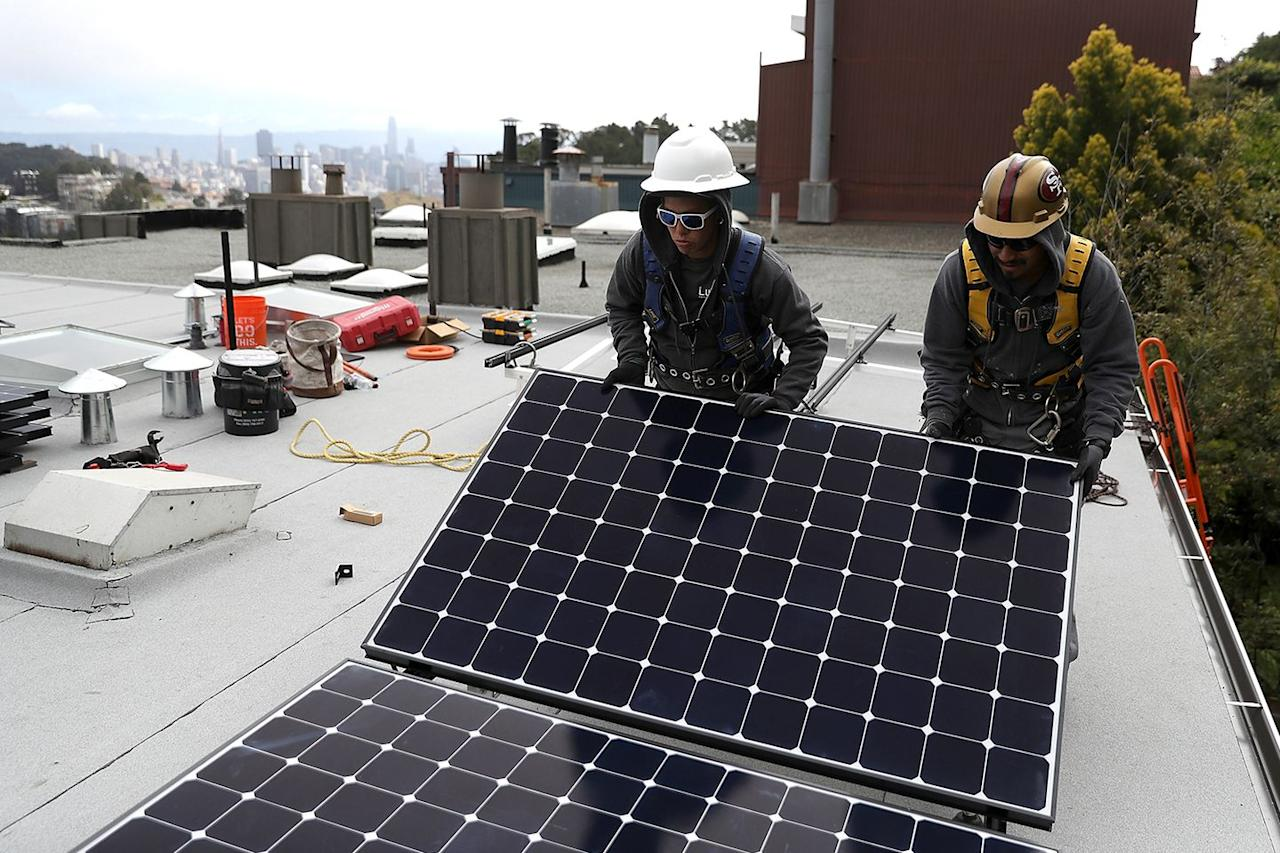 """<p>Luminalt solar installers set up solar panels on the roof of a home in San Francisco, California. <a rel=""""nofollow"""" href=""""https://www.nytimes.com/2018/05/09/business/energy-environment/california-solar-power.html"""">The state now requires</a> that most new homes built after January 2020 have solar panels. This is a huge environmental step for the state, and is expected to lower energy bills for homeowners. </p>"""