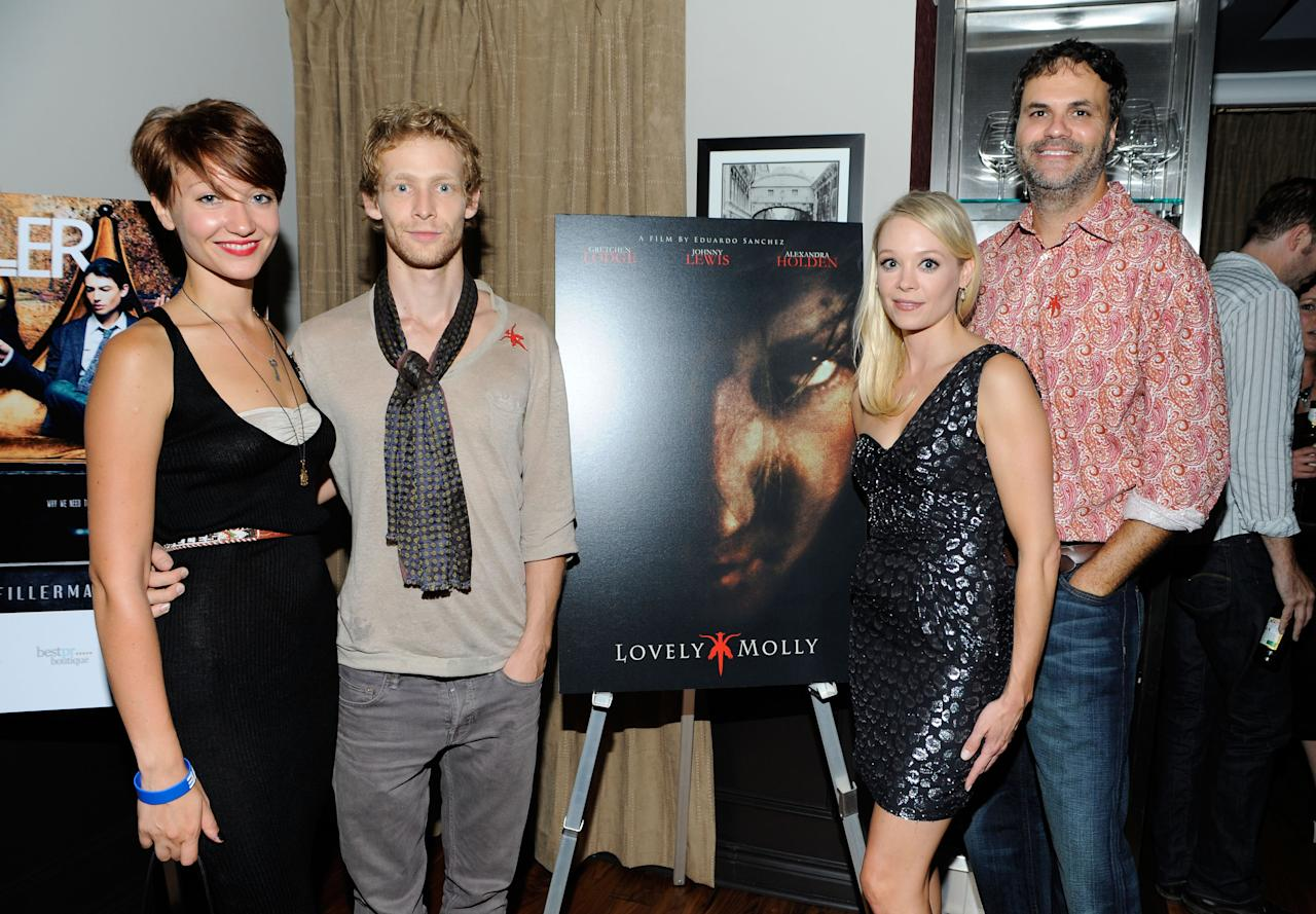 """TORONTO, ON - SEPTEMBER 14:  (L-R) Actors Gretchen Lodge, Johnny Lewis and Alexandra Holden with director Eduardo Sanchez at the """"Lovely Molly"""" Pre-Screening Cocktail Reception at TIFF Bell Lightbox on September 14, 2011 in Toronto, Canada.  (Photo by Clinton Gilders/Getty Images)"""