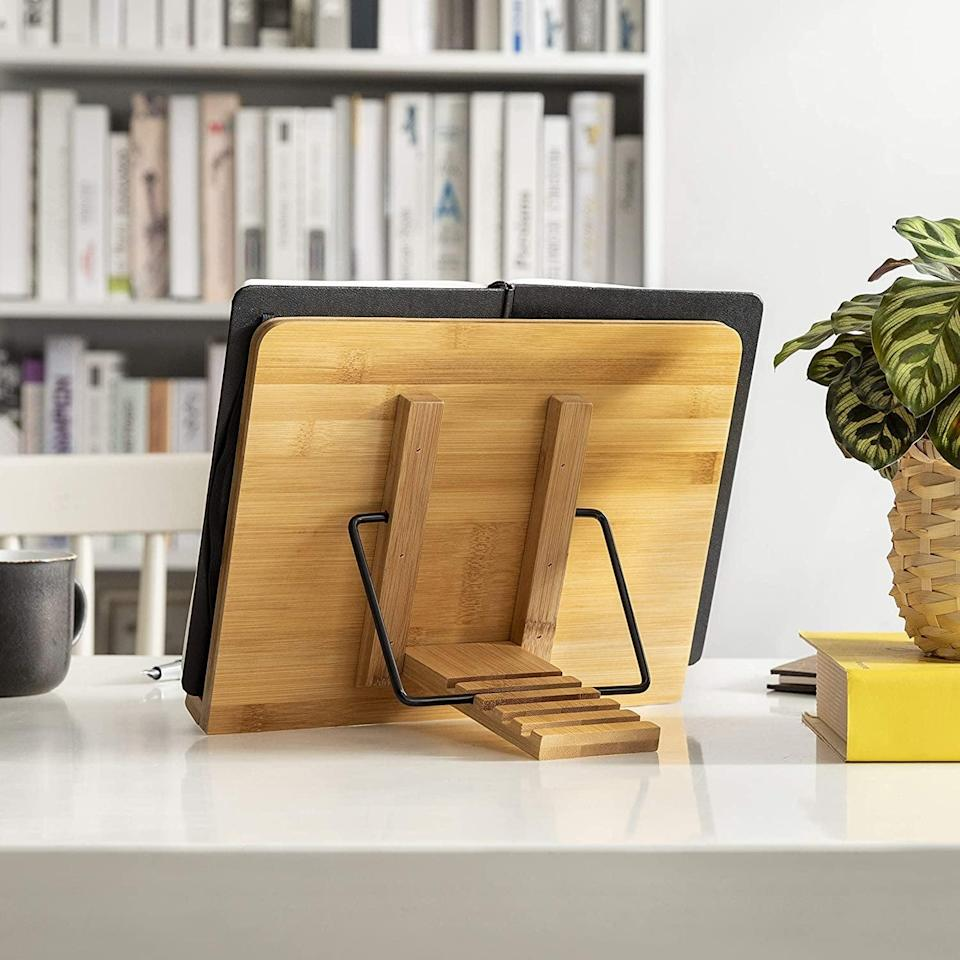 <p>Prop up your reading material with this <span>Wishacc Bamboo Book Stand</span> ($15, originally $20).</p>