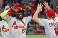 CORRECTS TO DOUBLE, INSTEAD OF SINGLE - St. Louis Cardinals left fielder Marcell Ozuna (23) celebrates his two-run double against the Atlanta Braves in the ninth inning during Game 1 of a best-of-five National League Division Series, Thursday, Oct. 3, 2019, in Atlanta. (AP Photo/John Bazemore)