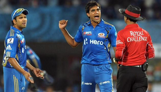 Mumbai Indians bowler Munaf Patel (C) and teammate Rohit Sharma (L) argue with the umpire about the wicket of Deccan Chargers captain Kumar Sangakkara during the IPL Twenty20 cricket match between Deccan Chargers and Mumbai Indians at Dr. Y.S. Rajasekhara Reddy Cricket Stadium in Visakhapatnam on April 9, 2012. AFP PHOTO / Noah SEELAM (Photo credit should read NOAH SEELAM/AFP/Getty Images)