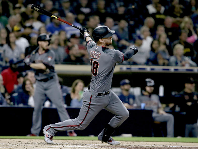 Arizona Diamondbacks' Carson Kelly follows through on a two-run single during the second inning of the team's baseball game against the San Diego Padres in San Diego, Friday, Sept. 20, 2019. (AP Photo/Alex Gallardo)